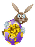 Easter bunny and giant egg Royalty Free Stock Photo