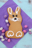 Easter bunny gingerbread cookie. On blue distressed wood table stock image