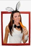 Easter bunny girl. Having her daily carrot Royalty Free Stock Images