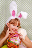 Easter bunny girl with basket. Easter bunny girl with funny ears holding eggs  in the basket Royalty Free Stock Photos