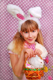 Easter bunny girl with basket. Easter bunny girl with funny ears holding eggs and rabbit in the basket Stock Images