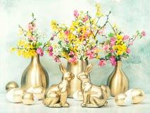 Easter bunny golden eggs flowers decoration vintage. Easter bunny with golden eggs and flowers decoration. Vintage style toned picture stock photo