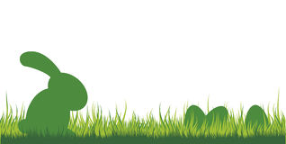 Easter Bunny in the grass. Illustration of an easter bunny sitting in the grass watching the eggs Royalty Free Illustration