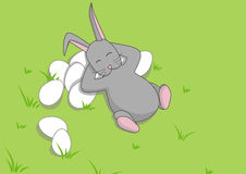 Easter Bunny on the grass. Easter Bunny with easter eggs on the grasss Stock Photo