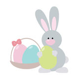 Easter Bunny with Green Egg. Cute cartoon easter bunny holding an egg. Nearby stands a basket with eggs Stock Images