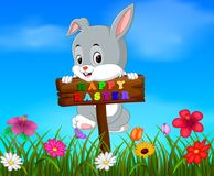 Easter bunny hanging up blank wood in garden stock illustration