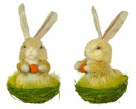 Easter bunny (hare). Two shots of easter decoration - hare with egg Stock Photo