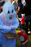 The Easter bunny has arrived. The Easter bunny is greeted by children at a public park Royalty Free Stock Images