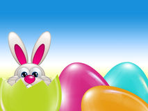 Easter bunny hatched from egg over blue sky Stock Photography