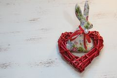 Easter bunny and heart stock photography