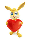 Easter Bunny with heart sign Stock Photo
