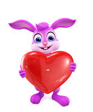 Easter Bunny with heart sign Stock Photos