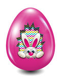Easter bunny hidden in egg hollow over white Royalty Free Stock Images