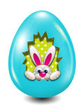 Easter bunny hidden in egg hollow over white Royalty Free Stock Image