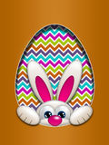 Easter bunny hidden in egg hollow Stock Photography