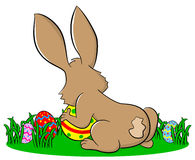 Easter bunny hiding eggs vector illustration