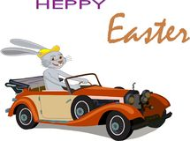 Easter Bunny on his red Easter car royalty free stock photo