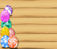 The Easter bunny holding a basket of Easter eggs with more Easter eggs  and wood sign boar Stock Image