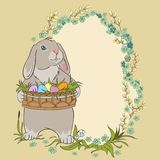 Easter bunny holding a basket with eggs. Retro card Royalty Free Stock Images