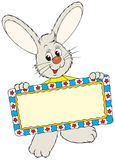 Easter Bunny holding a decorative frame Stock Images