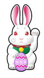 Easter bunny holding easter egg Stock Photo