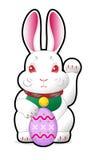 Easter bunny holding easter egg stock photo