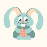 Easter bunny holding Easter egg outline blue Royalty Free Stock Photo