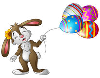 Easter bunny holding easter eggs balloons. Illustration of Easter bunny holding easter eggs balloons Stock Photo