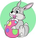 Easter bunny holding an egg. The character is drawn in a classic style. Isolated on white background Royalty Free Stock Photo