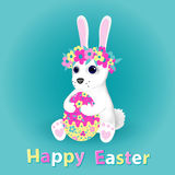 Easter bunny holding egg. The symbol of the Feast. Vector illustration. Royalty Free Stock Photos