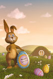Easter bunny holding an egg with the words 'Happy Easter' Royalty Free Stock Photo