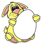 Easter bunny holding white egg Royalty Free Stock Photos
