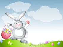 Easter Bunny Hopping With Basket of Eggs Royalty Free Stock Photography
