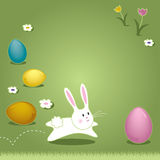 Easter Bunny Hopping Through Grass Stock Photography