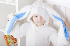 Easter bunny with huge ears in hands. Royalty Free Stock Photography