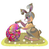 Easter bunny hugging an Easter egg Royalty Free Stock Photography