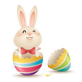 Easter bunny inside a cracked easter egg Royalty Free Stock Photo