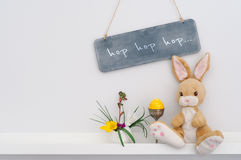 Easter bunny interior decoration. With hop, hop, hop inscription stock image