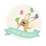 A Easter bunny juggling eggs. royalty free stock photography