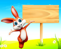 Easter bunny jumping before wooden sign Stock Photography