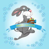 Easter Bunny jumps and collects Easter eggs with blue tape Stock Image
