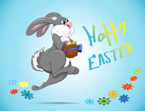 Easter Bunny jumps and collects Easter eggs colourfull Royalty Free Stock Image