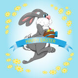 Easter Bunny jumps with yellow flower Royalty Free Stock Photo