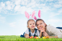 Easter bunny. Little girl with mother dressed as the Easter bunn Stock Photography