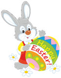 Easter Bunny. Little grey rabbit and a decorated egg with a Happy Easter greeting Stock Photography