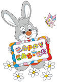 Easter Bunny. Little rabbit holding an Easter card Royalty Free Stock Images