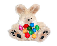 Easter bunny with lots of colorful eggs Royalty Free Stock Images