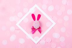 Easter bunny with confetti on pink background. stock image