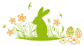 Easter bunny, meadow. Colorful spring meadow, eggs and easter bunny Stock Images
