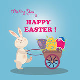 Easter Bunny moves eggs in trolley Stock Photography